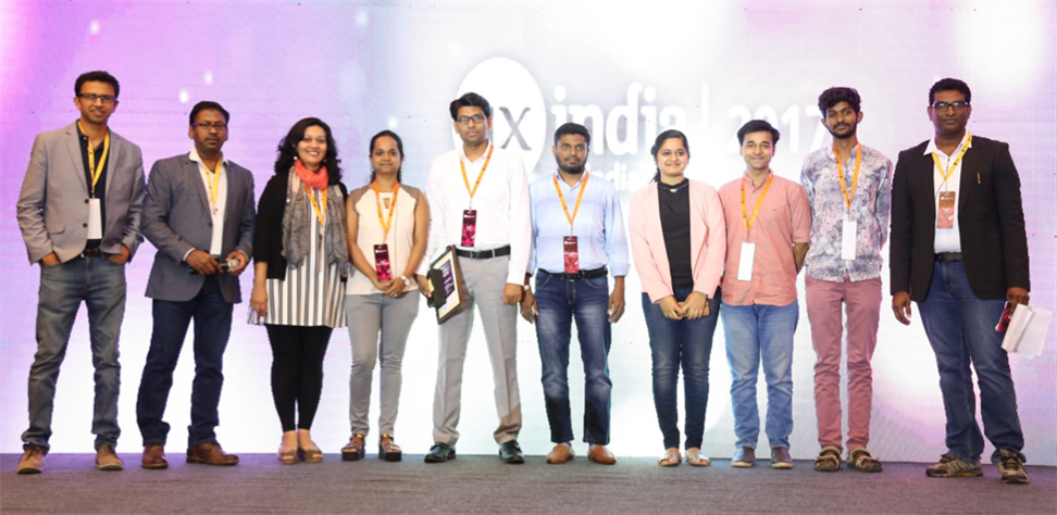 The organizers with the design awards winners on stage.