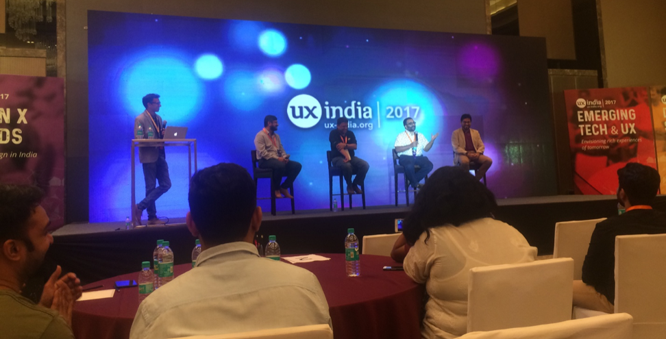 Panelists on stage giving their ideas about the necessary skills for a UX designer to be successful
